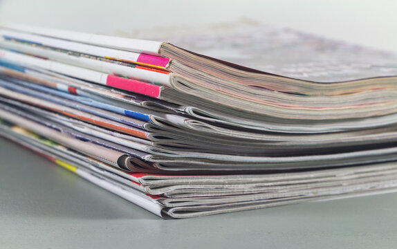 Pile of french magazine on a table