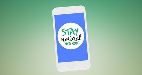 Composition of stay natural text and leaf logo on blue smartphone screen, over green background