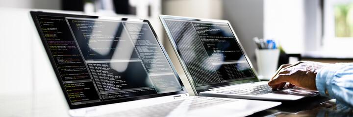 Obraz African American Coder Using Computer At Desk - fototapety do salonu