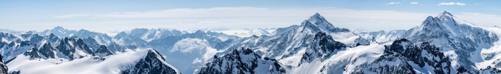 Switzerland, Panoramic view on Snow Alps and Blue Sky around Titlis mountain