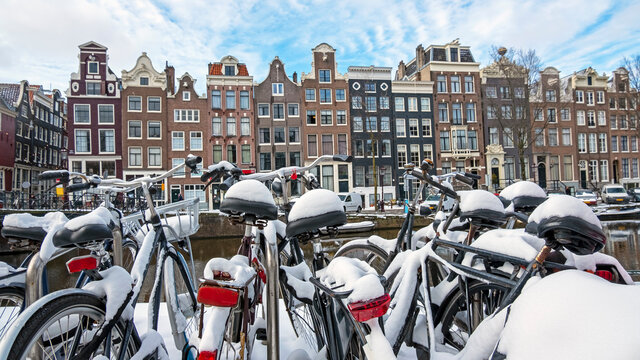 City scenic from a snowy Amsterdam in winter in the Netherlands