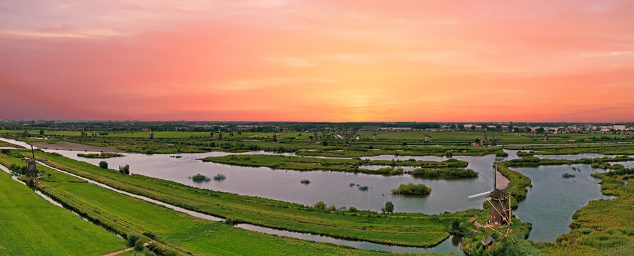Aerial panorama from the windmills at Kinderdijk in the Netherlands at sunset
