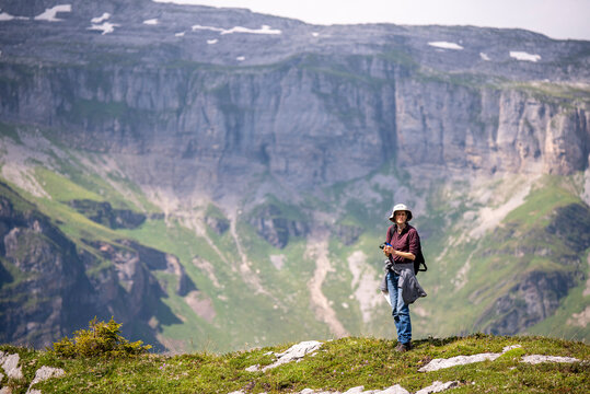 hiker on the top of a mountain range in the Swiss Alps