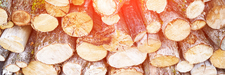 Wood chop stove. Woodpile texture background. Trees store. Hardwood pile stack. Wooden biomass wall. Split forest. Agriculture work. Round shape