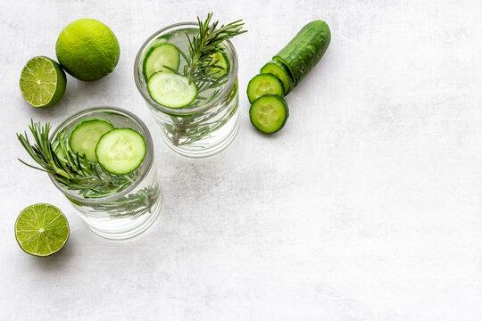 Homemade lemonade with cucumber lemon slices and herbs
