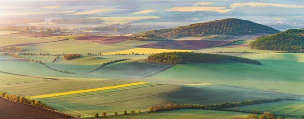 Obraz Spring hilly landscape of fields Czech republic - fototapety do salonu