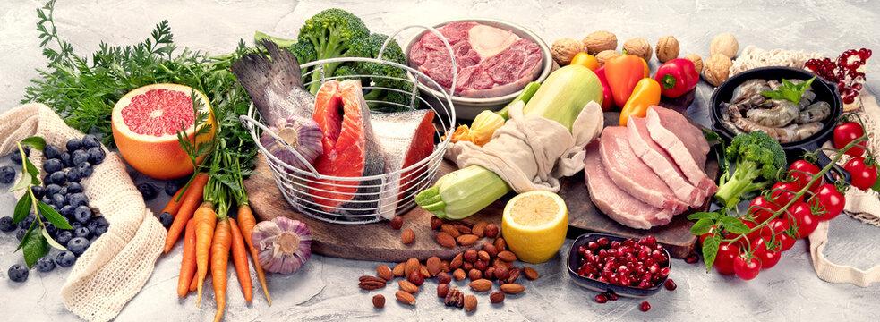 Paleo diet food on light gray background.