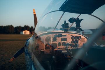 Obraz Cockpit view from small private single motor airplane. - fototapety do salonu