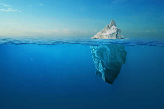 Iceberg With Above And Underwater View Taken In Greenland. Iceberg - Hidden Danger And Global Warming Concept. Iceberg illusion creative idea