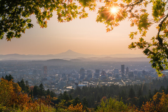 Portland Downtown and Mt Hood with sunshine behind autumn foliage