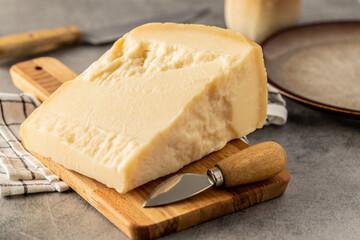 Block of italian parmesan cheese.