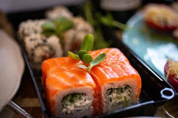 Fototapeta Selective focus shot of Philadelphia sushi rolls in a plastic container at a restaurant obraz