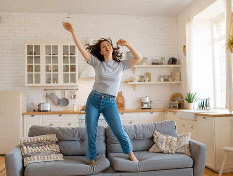 woman jumping on the sofa