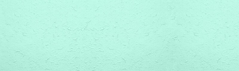 Obraz Rough crumpled surface large texture. Pastel mint green textured surface abstract wide background - fototapety do salonu