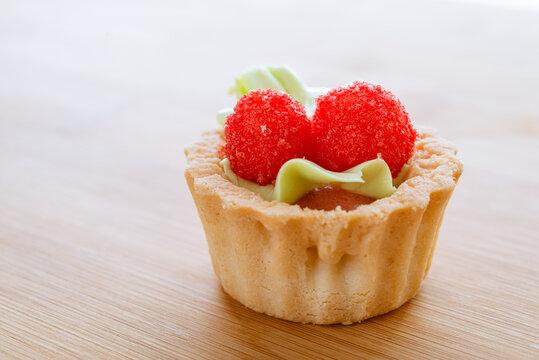 Tasty cupcake Homemade Birthday cupcake with red sweet berries