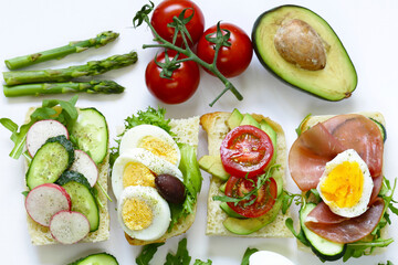 sandwiches with different fillings - vegetables, ham and egg