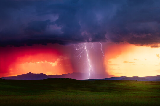 Scenic New Mexico landscape with sunset lightning storm over a mountain