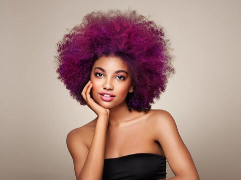 Beauty portrait of African American girl with colorful dyed afro hair. Beautiful black woman. Cosmetics, makeup and fashion