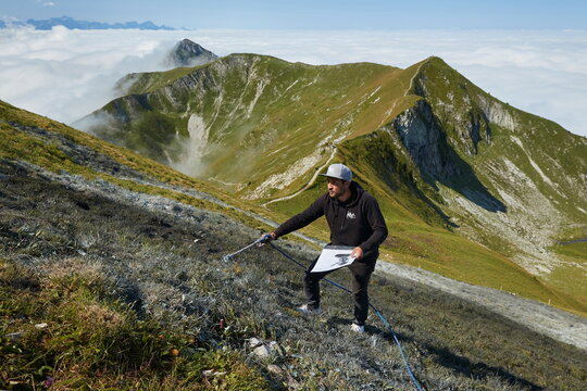 """French artist SAYPE gives the final touch to his land art painting """"Un nouveau souffle"""" at the Moleson summit near Gruyeres"""