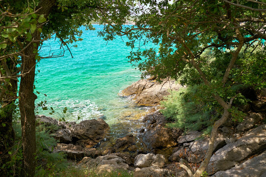 Rocky coast of the Adriatic Sea on the island of Krk near the town of the same name Krk in Croatia