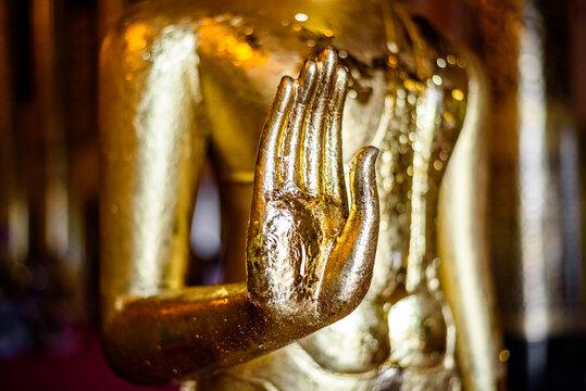 Golden Buddha statue in thai temple, Chiang mai, Thailand