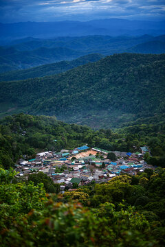Top landscape View of  mountain village on Doi Pui Mountains in sunset sky and clouds , Chiangmai , Thailand