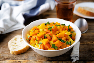 Pumpkin potato carrot stew in the bowl