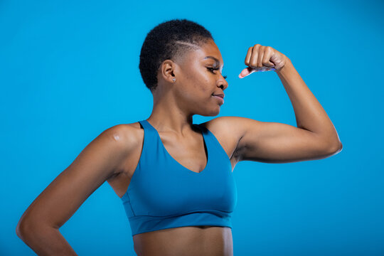 Portrait of fit African American woman in fitness wear with copy-space