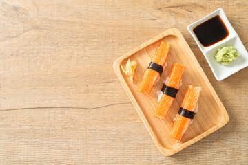 Fototapeta Crab Stick Sushi on wood plate obraz