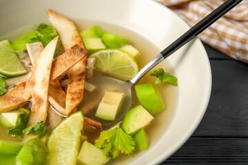 Plate of tasty Sopa de Lima soup on table, closeup