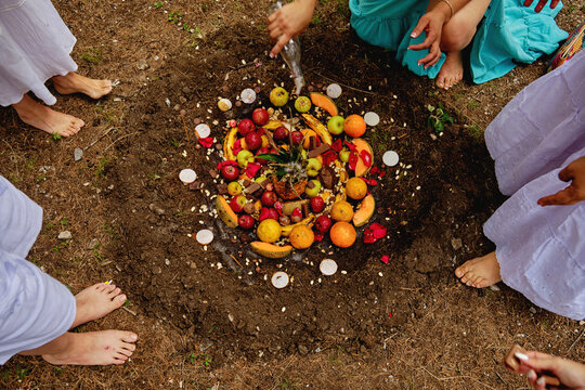 Female Friends Around Fruits In Pit Performing Temazcal Ritual