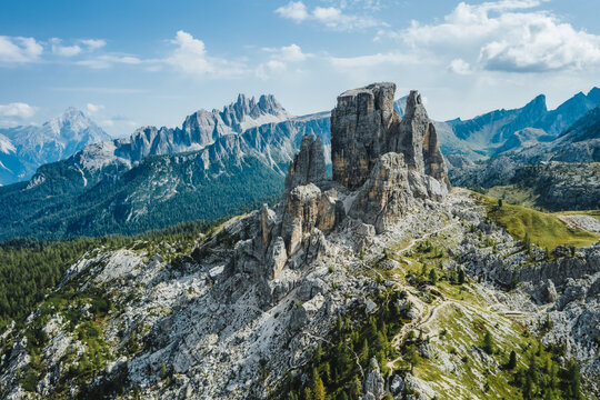 Aerial view of Cinque Torri in Dolomites mountains in Italy. Epic landscape on a sunny day of summer