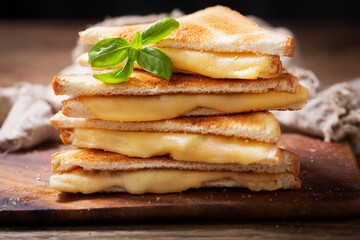 Grilled sandwiches with melted cheese