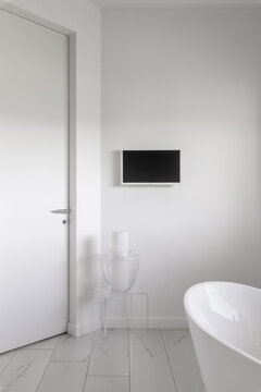 Glamor bathroom interior with trendy grey design with white furniture
