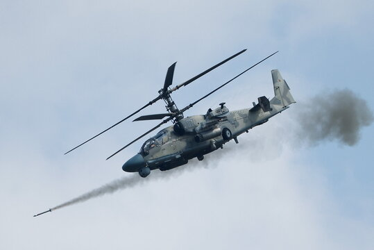 """A Russian Ka-52 """"Alligator"""" military helicopter fires a missile during the Aviadarts competition outside Ryazan"""