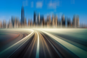 Futuristic scene Motion blur movement between elevated train line over the railroad tracks with building at the Loop line at New York city, USA, innovation and technology concept