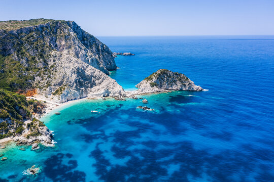 Aerial view Agia Eleni beach in Kefalonia Island, Greece. Remote beautiful rocky beach with clear emerald water and high white cliffs
