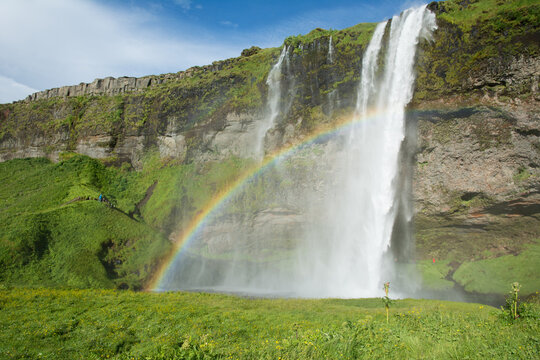 Seljalandsfoss waterfall with a rainbow, Iceland