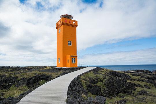 Bright orange lighthouse on the coast