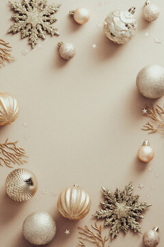 Elegant Christmas balls and decorations on beige background. Fashion Xmas poster design, vertical banner mockup. Flat lay, top view, copy space.