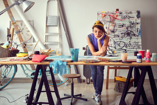 Caucasian female painter artist creating a piece