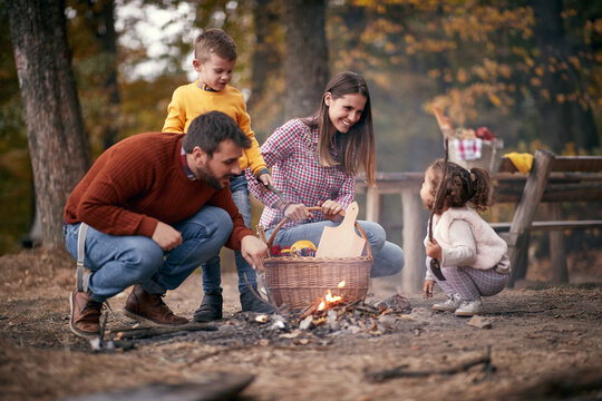 Happy family preparing for a picnic in the forest