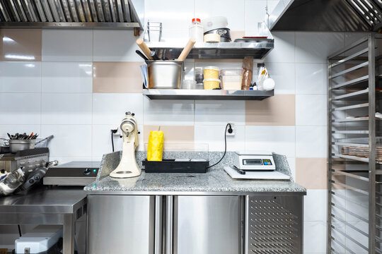 Restaurant kitchen without anyone. Small pastry shop. Kitchen with restaurant equipment. Concept - sale of equipment for restaurant. Mixer and scales in cafe kitchen. Equipment for HoReCa sphere.