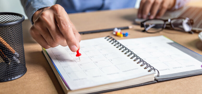 Businessman agenda calendar and reminder agenda work online at home men plan daily appointments and vacation travel journals in a diary at their desk . calendar reminder event concept .