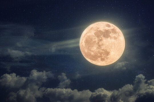 Amazing full moon on blue night sky with stars and clouds. Halloween wallpaper