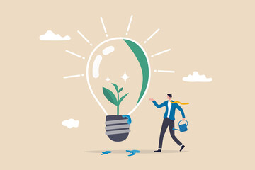 Obraz Ecology and sustainable business, green idea or protection against world climate change, environmental care concept, smart businessman watering seedling sprout growing inside green lightbulb idea. - fototapety do salonu