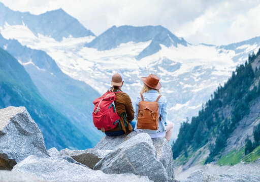 Travelers enjoy the view of the mountain valley. Travel and active life concept with team. Adventure and travel in the mountains region in the Austria