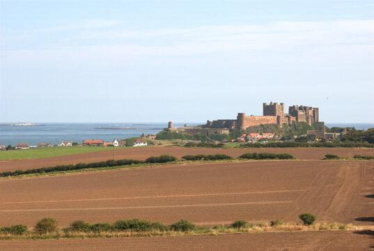 Bamburgh castle in summer sun in Northumberland