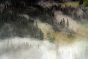Morning mists on the Podhale slope. Mountain landscape. Podhale and Tatra Mountains views.
