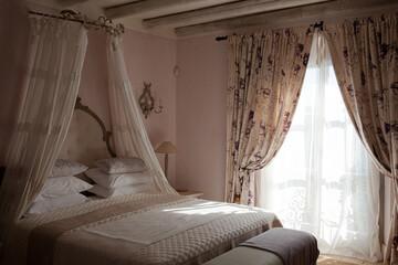 Fototapeta Bed with canopy in luxury bedroom obraz
